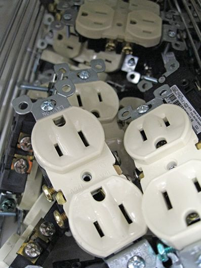 electrical receptacles in store bin